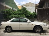 Pearl white Toyota Camry 97' automatic
