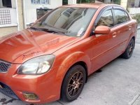 Selling Orange Kia Rio 2011 Automatic Gasoline in Quezon City