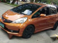 Selling Orange Honda Jazz 2013 in Quezon City