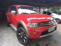 Red Mitsubishi Strada 2011 at 67256 km for sale