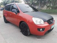 Orange Kia Carens 2007 for sale in Talisay