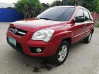 Red Kia Sportage 2010 for sale in Talisay