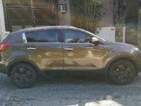 Selling Brown Kia Sportage 2012 Automatic Gasoline at 68000 km