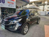 Sell Black 2011 Kia Sportage in Quezon City