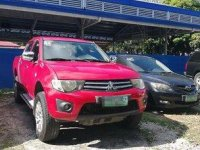 Red Mitsubishi Strada 2011 at 67000 km for sale