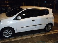 Pearlwhite Toyota Wigo 2014 for sale in Malolos