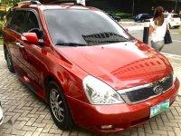 Red Kia Carnival 2012 for sale in Manila