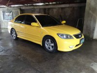 Yellow Honda Civic 2004 for sale in Sta. Rosa-Nuvali Rd.