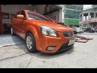 Selling Orange Kia Rio 2010 Sedan in Manila