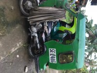 Selling Green Kia Carens in Tubod