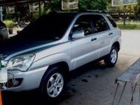 Sell Silver Kia Sportage in Muñoz