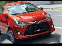 Orange Toyota Wigo for sale in Quezon City