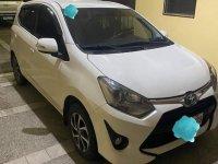 Pearl White Toyota Wigo for sale in Quezon