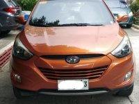 Sell Orange Hyundai Tucson in Manila