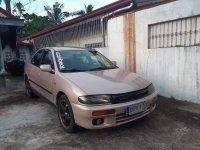 Selling Brown Mazda 323 1997 in San Pedro