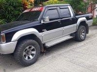 Selling Black Mitsubishi Strada 1995 in Davao
