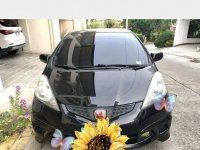 Black Honda Jazz 2010 for sale in Nasipit