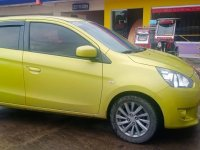 Selling Yellow Mitsubishi Mirage 2013 in Tabaco