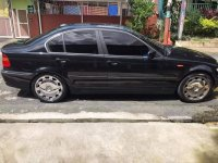 Black BMW 318I 2004 for sale in Quezon