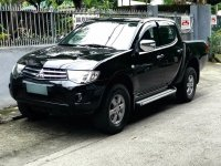 Black Mitsubishi Strada 2012 for sale in Quezon