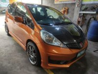 Selling Orange Honda Jazz 2012 in Valenzuela