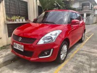 Red 2016 Suzuki Swift Hatchback