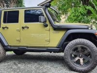 Selling Green Jeep Wrangler 2014 in Antipolo