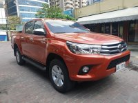 Orange Toyota Hilux 2019 for sale in Pasig