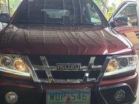 Selling Red Isuzu Sportivo X 2013 in Dasmariñas