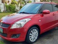 Sell Red 2011 Suzuki Swift in Parañaque