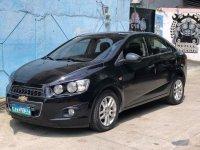 Black Chevrolet Sonic 2013 for sale in Samal