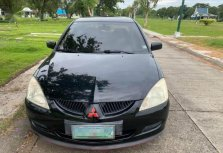 Black Mitsubishi Lancer for sale in Rosario