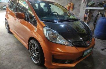 Selling Orange Honda Jazz 2012 in Valenzuela
